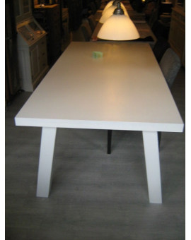 Solid wood dining table with angled legs.